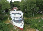 House that Looks like a Boat, on Lake Huron is for...