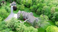 10 plus Car Garage Space with this 10 Acre Estate