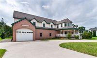 6 to 8 Car Garage in this Custom  home, with open ...